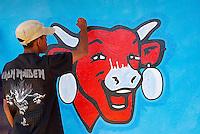 """Madagascar. Peinture publicitaire pour le fromage """"la vache qui rit"""". // Madagascar. Advertising painting for french cheese """"La vache qui rit"""" (laugh cow)."""
