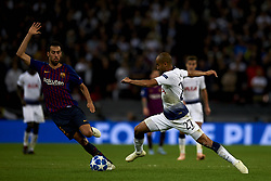 October 3, 2018 - London, England, United Kingdom - Lucas of Tottenham and Sergio Busquets of Barcelona  battle for the ball during the Group B match of the UEFA Champions League between Tottenham Hotspurs and FC Barcelona at Wembley Stadium on October 03, 2018 in London, England. (Credit Image: © Jose Breton/NurPhoto/ZUMA Press)