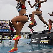 Action at the water jump during the Women's 3000m Steeplechase race won by Lidya Chepkurui, Kenya, at the Diamond League Adidas Grand Prix at Icahn Stadium, Randall's Island, Manhattan, New York, USA. 25th May 2013. Photo Tim Clayton