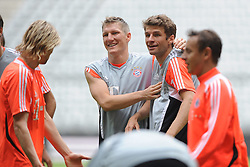 14.05.2013, Allianz Arena, Muenchen, GER, UEFA CL, FC Bayern Muenchen, Medientag, im Bild Bastian SCHWEINSTEIGER (FC Bayern Muenchen) und Thomas MUELLER (FC Bayern Muenchen) gutgelaunt // during the open media day of FC Bayern Munich in front of the UEFA Champions League Final 2013 held at the Alianz Arena, Munich, Germany on 2013/05/14. EXPA Pictures © 2013, PhotoCredit: EXPA/ Eibner/ Wolfgang Stuetzle..***** ATTENTION - OUT OF GER *****