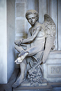 Picture and image of the stone sculpture of an angel in 19th century Borgeois Realistic style. The monumental tombs of the Staglieno Monumental Cemetery, Genoa, Italy .<br /> <br /> Visit our ITALY PHOTO COLLECTION for more   photos of Italy to download or buy as prints https://funkystock.photoshelter.com/gallery-collection/2b-Pictures-Images-of-Italy-Photos-of-Italian-Historic-Landmark-Sites/C0000qxA2zGFjd_k<br /> If you prefer to buy from our ALAMY PHOTO LIBRARY  Collection visit : https://www.alamy.com/portfolio/paul-williams-funkystock/camposanto-di-staglieno-cemetery-genoa.html