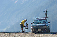 Young man mountain biking in Mount Rainier National Park, WA.<br />