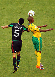 Mexico's Ricardo Osorio vs South Africa's Katlego Mphela during the Group A first round 2010 FIFA World Cup South Africa match between South Africa and Mexico at Soccer City Stadium on June 11, 2010 in Johannesburg, South Africa.  (Photo by Vid Ponikvar / Sportida)