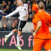 NLD/Amsterdam/20121114 - Vriendschappelijk duel Nederland - Duitsland, lewis Holtby in duel met Bruno Martins Indi