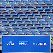 NLD/Hilversum/20050609 - Golf, KLM Open 2005, lege tribune met reclame borden