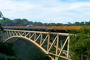 The Victoria Falls Bridge marks the border between Zambia and Zimbabwe in Southern Africa