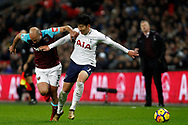 Son Heung-min of Tottenham Hotspur (R) battles with Pablo Zabaleta of West Ham United (L). Premier league match, Tottenham Hotspur v West Ham United at Wembley Stadium in London on Thursday  4th January 2018.<br /> pic by Steffan Bowen, Andrew Orchard sports photography.