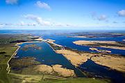 Nederland, Friesland, Gemeente Dongeradeel, 28-02-2016; voormalige Lauwerszee en Ezumakeeg gezien naar Ezumazijl en Oostmahorn. Waddenzee en Ameland aan de horizon. Natuurgebied op de grens van het Lauwersmeer en Kollumerwaard.<br /> Nature area on the border of former inner sea.<br /> luchtfoto (toeslag op standard tarieven);<br /> aerial photo (additional fee required);<br /> copyright foto/photo Siebe Swart