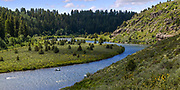 Driftboat on the Warm River to Ashton section of the Henry's Fork. The ridgeline on river right  is formed from the ancient Island Park caldera. Published Catch Magazine June 2015