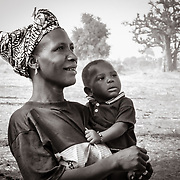 Senegalese mother holding her baby boy