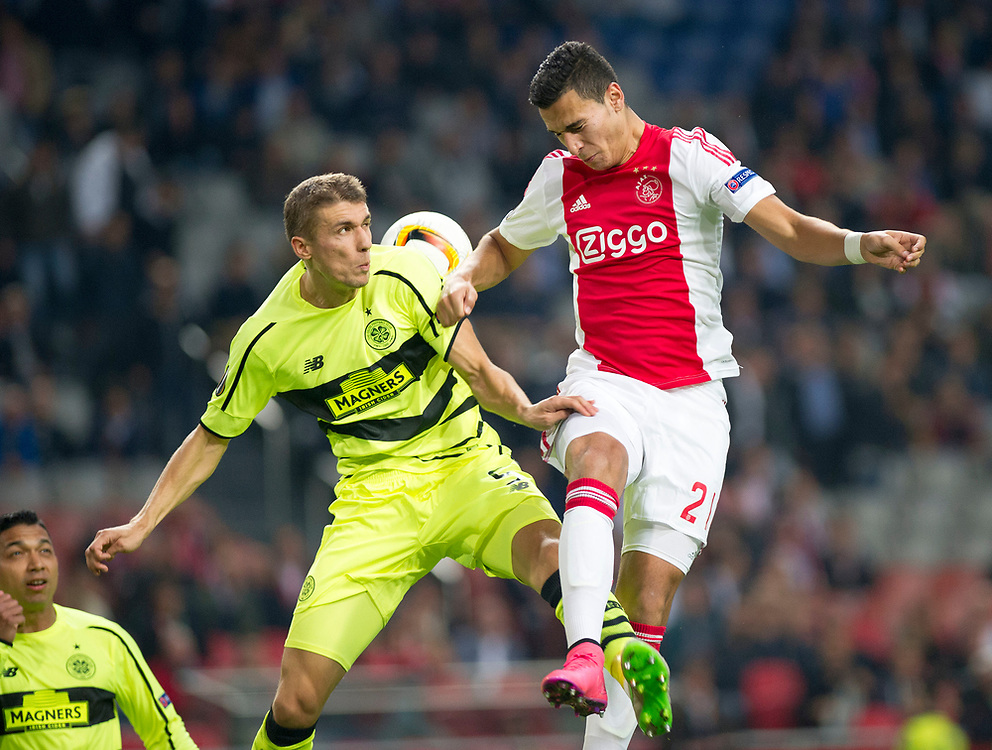 Ajax's Anwar El Ghazi and Celtic's Jozo Simunovic vie for the ball during the Europe League Group A soccer match between Ajax Amsterdam and Celtic Glasgow at the ArenA stadium in Amsterdam, Netherlands, Thursday, Sept. 17, 2015. (AP Photo/Patrick Post)
