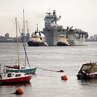 London, UK - 13 July 2012: Royal Navy's biggest ship HMS Ocean sails up Thames towards Greenwich where it will be deployed as part of the security plan for the Olympic Games.