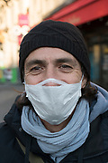 """April, 1st 2020 - Paris, Ile-de-France, France: Parisians wearing a range of masks and facial coverings in the hope of protecting themselves from the spread of the Coronavirus, during the twelfth day of near total lockdown imposed in France. A week after President of France, Emmanuel Macron, said the citizens must stay at home for at least 15 days, that has been extended. He said """"We are at war, a public health war, certainly but we are at war, against an invisible and elusive enemy"""". All journeys outside the home unless justified for essential professional or health reasons are outlawed. Anyone flouting the new regulations is fined. Nigel Dickinson"""