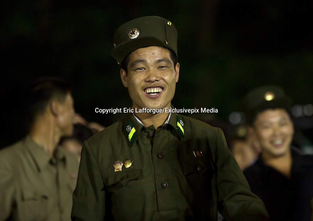 """I Have Seen North Korean People Smiling!<br /> <br /> """"Some say about North Korea that the only ones who smile are the """"Dear Leaders"""" on the propaganda stuff"""", says Photographer Eric Lafforgue<br /> <br /> But after 6 trips in the most closed country, I can say that North Koreans are not the robots many depict... They also smile!<br /> <br /> Even if they suffer from the lack of freedom and a dictatorship, they can have happy moments in their life... This was not easy to take those pics as the guides that always follow you are always suspicious, even when they see happy people!<br /> ©Eric Lafforgue/Exclusivepix Media"""