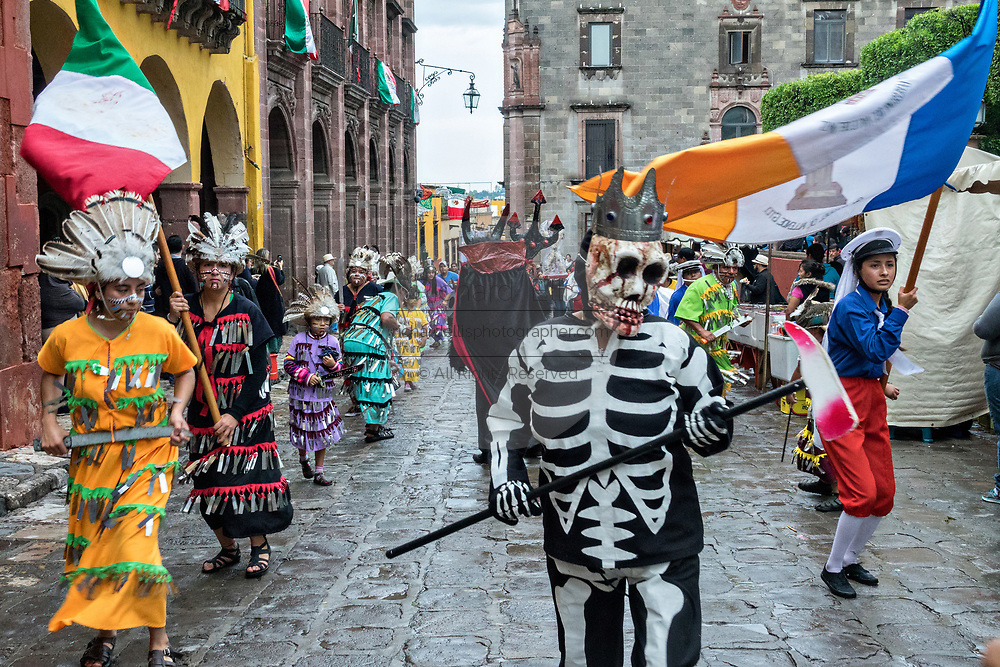 The skeleton king leads a procession through the Jardin Allende during the week long fiesta of the patron saint Saint Michael September 24, 2017 in San Miguel de Allende, Mexico.
