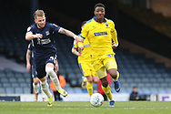 AFC Wimbledon defender Paul Kalambayi (30) battles for possession with Southend United midfielder Luke Hyam (4)during the EFL Sky Bet League 1 match between Southend United and AFC Wimbledon at Roots Hall, Southend, England on 16 March 2019.