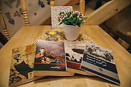 Three Arabic language books on the Syrian revolution, available at Pages bookshop.