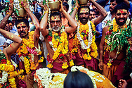 Village elders carry the village gods on their heads during a festival in Tamil Nadu, India.