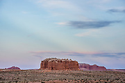 Clouds cast subtle shadows across blue sky at dusk over Goblin Valley State Park, in the San Rafael Swell, Utah, USA.