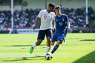 Vontae Daley-Campbell of England (12) and Andrea Mattioli of Italy (11) during the UEFA European Under 17 Championship 2018 match between England and Italy at the Banks's Stadium, Walsall, England on 7 May 2018. Picture by Mick Haynes.