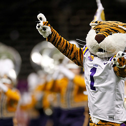 Jan 9, 2012; New Orleans, LA, USA; The LSU Tigers marching band and Mike the Tiger perform before the 2012 BCS National Championship game against the Alabama Crimson Tide at the Mercedes-Benz Superdome.  Mandatory Credit: Derick E. Hingle-US PRESSWIRE