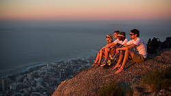 Hikers overlooking Clifton beaches from Lions Head, Cape Town, South Africa. 08/01/15. Photo by Andrew Tallon