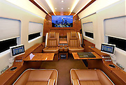"How's that for a way to travel: Luxury limousine comes fitted out with drinks cabinet, computer system and even an exercise bike<br /> <br /> <br /> For most of us, taking a trip in the car means missing out on certain luxuries which we enjoy at home.<br /> However, for anyone wealthy enough to own this luxury limousine, that needs not be the case.<br /> The opulent vehicle comes fitted out with a number of incredible features, including a built-in exercise bike which can be used whilst sitting back in one of the leather seats.<br /> <br /> The vehicle also comes with a burr wood trimmings drinks cabinet, large screen HD television, surround sound system, wifi and computer system.<br /> There is also the option of armour plating for those high profile oligarchs or even politicians around the world who believe they need the security.<br /> The Cadillac Escalade ESVconversions vehicle has been made by US custom company Becker Automotive Designs.<br /> <br /> The vehicle costs between £83,500 and £161,000 depending on the final specifications.<br /> In advertising the vehicle, the company says: 'Gaining the edge in today's competitive business environment means using every minute of your busy day to its best advantage. <br /> 'The Becker Cadillac Escalade ESV allows you to transform travel time into some of the most tranquil, focused and productive time in your schedule.<br /> <br /> 'Powerfully equipped-with all of the comforts and amenities of the office at your fingertips, for those who appreciate the value of time.<br /> 'Manage correspondence, access the internet and get news and market updates on a full sized display integrated into the cabins Crestron-controlled privacy partition. <br /> 'Make calls and hold conferences when others simply cant. Becker's full mobile office suite allows voice and video communication any time.<br /> 'Conduct meetings in your quiet, spacious ""boardroom"" and even produce documents on demand.<br /> 'Take the rush out of rush hour. Spend your private time any way you like. Watch a movie, or just rest and relax in a spacious interior that no Euro"