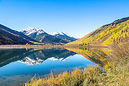 Autumn reflection at Crystal lake high in the San Juan Mountains of Ouray Colorado