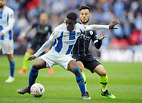 Football - 2018 / 2019 Emirates FA Cup - Semi-Final: Manchester City vs. Brighton & Hove Albion<br /> <br /> Yves Bissouma of Brighton and David Silva of Man City, at Wembley Stadium.<br /> <br /> COLORSPORT/ANDREW COWIE