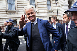 © Licensed to London News Pictures. 09/06/2018. London, UK. GEERT WILDERS is escorted away by police from a demonstration in support of Tommy Robinson ( real name Stephen Yaxley-Lennon ) in Whitehall in Westminster . Robinson has been convicted of Contempt of Court . Robinson was already serving a suspended sentence for Contempt of Court over a similar incident , when he was convicted on Friday 25th May 2018 . Photo credit: Joel Goodman/LNP