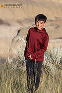 Young boy happy during family hike on the Diane Gabriel Trail at Makoshika State Park in Glendive, Montana, USA