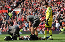 Liverpool's Andrew Robertson lies injured on the pitch