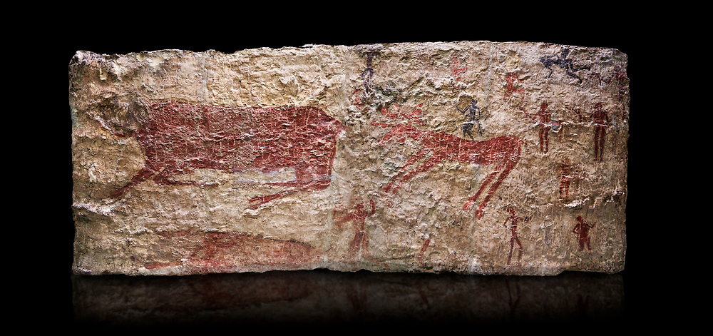 Hunting scene. A deer and wild boar are depicted being hunted with people using bows and arrows. One person is depcted trying to net the boar. 6000 BC,  Catalhoyuk Collections. Museum of Anatolian Civilisations, Ankara. Against a black background .<br /> <br /> If you prefer you can also buy from our ALAMY PHOTO LIBRARY  Collection visit : https://www.alamy.com/portfolio/paul-williams-funkystock/prehistoric-neolithic-art.html - Type Catalhoyuk into the LOWER SEARCH WITHIN GALLERY box. Refine search by adding background colour, place, museum etc.<br /> <br /> Visit our PREHISTORIC PLACES PHOTO COLLECTIONS for more  photos to download or buy as prints https://funkystock.photoshelter.com/gallery-collection/Prehistoric-Neolithic-Sites-Art-Artefacts-Pictures-Photos/C0000tfxw63zrUT4