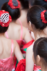 USA, Washington, Seattle. Young girls perform traditional Chinese dance at the Lunar New Year festival.