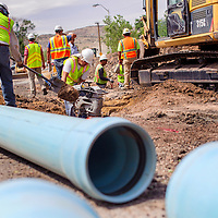 062614       Cable Hoover<br /> <br /> A construction crew from contractor Century Club Construction replaces the water main underneath Grandview Drive in Gallup Thursday. Century Club is expected to complete their part of the project by July 10 before starting a similar project on Country Club Drive.