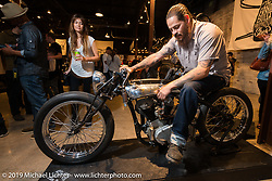 Cristian Sosa of Sosa Metal Works (Las Vegas, NV) on his Suavecito Pomade Indian Boardtracker Motorcycle during the Friday night opening of the Handbuilt Motorcycle Show. Austin, TX. April 10, 2015.  Photography ©2015 Michael Lichter.
