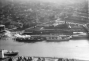 "ackroyd-04292-8. ""April 1, 1953"" Union Station, UP rail yards, Lovejoy Viaduct, Broadway Bridge & NW Portland looking west."