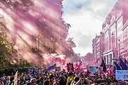 Smoke is released as The march which was estimated to total over 650,000 heads up Piccadilly - The People's Vote March For The Future demanding a Vote on any Brexit deal. The protest assembled on Park Lane and then marched to Parliament Square for speeches.