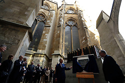 The Prince of Wales unveils a plaque on a foundation stone for a new stair and lift tower flanked by the Dean of Westminster John Hall (right) during his visit to the The Queen's Diamond Jubilee Galleries at Westminster Abbey in London.