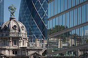 Varied architecture, including the modern Gherkin and the rotunda of Electra House in the City of London.