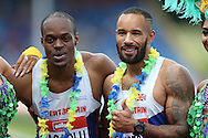 James Dasaolu who won the Mens 100 metres final race poses with James Ellington as both athletes qualified for the Rio 2016 Olympics. The British Championships 2016, athletics event at the Alexander Stadium in Birmingham, Midlands  on Saturday 25th June 2016.<br /> pic by John Patrick Fletcher, Andrew Orchard sports photography.