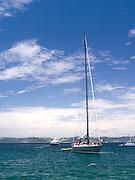 View from Motuarohia Island across the Bay of Islands. Sailboats moored.