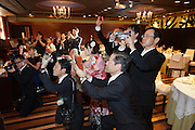 group of guests and a professional photographer taking pictures at a wedding party Japan