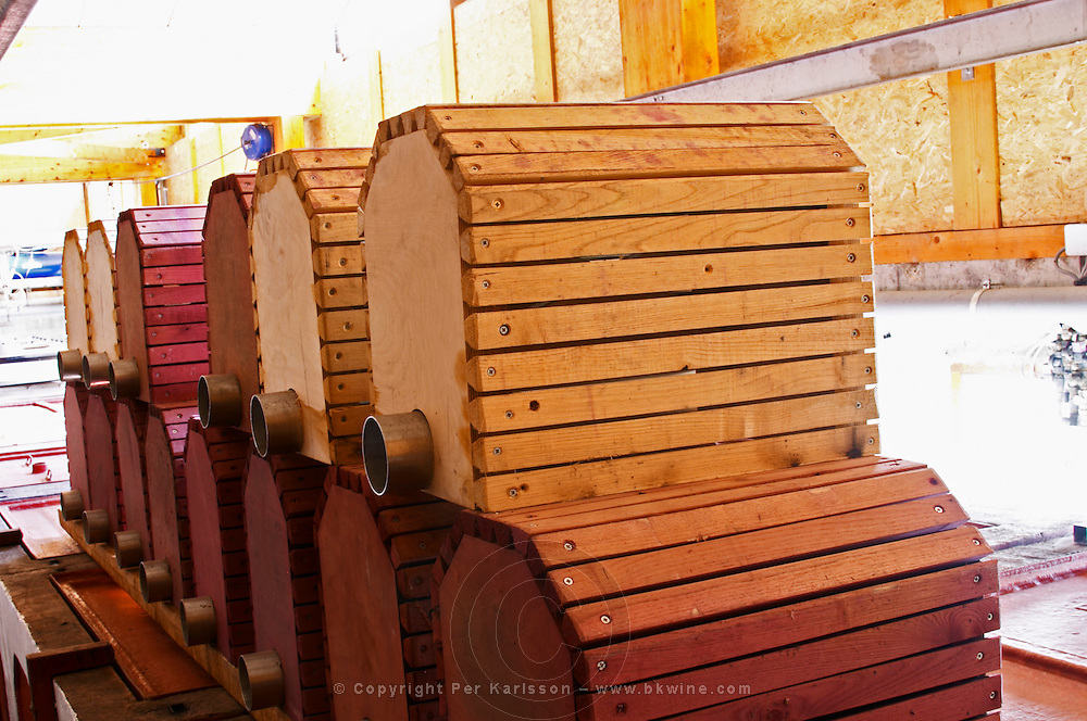 """Wooden """"filters"""". These are placed inside the fermentation tanks and used as coarse filters when the tank is empties. It keeps the grape skins and other solid matter inside and avoids clogging the pipes.  Domaine Yves Cuilleron, Chavanay, Ampuis, Rhone, France, Europe"""
