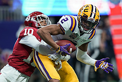 Justin Jefferson #2 of the LSU Tigers reaches for a touchdown during the first half against the Oklahoma Sooners in the 2019 College Football Playoff Semifinal at the Chick-fil-A Peach Bowl on Saturday, Dec. 28, in Atlanta.  (Jason Parkhurst via Abell Images for the Chick-fil-A Peach Bowl)