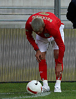 Photo: Paul Thomas.<br /> Estonia v England. UEFA European Championships Qualifying, Group E. 06/06/2007.<br /> <br /> David Beckham of England feels for his ankle and lower leg before kicking a corner.