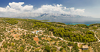 Aerial panoramic view of Brac island, villa and mountains, Sumartin, Croatia.