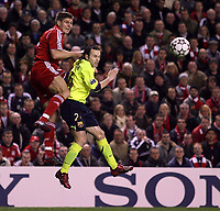Photo: Paul Thomas.<br /> Liverpool v Barcelona. UEFA Champions League. Last 16, 2nd Leg. 06/03/2007.<br /> <br /> Steven Gerrard (Red) of Liverpool jumps above Andres Iniesta.