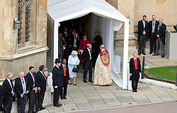 Queen Elizabeth II and the Duke of Edinburgh leave St George's Chapel in Windsor Castle, following the wedding of Princess Eugenie to Jack Brooksbank.