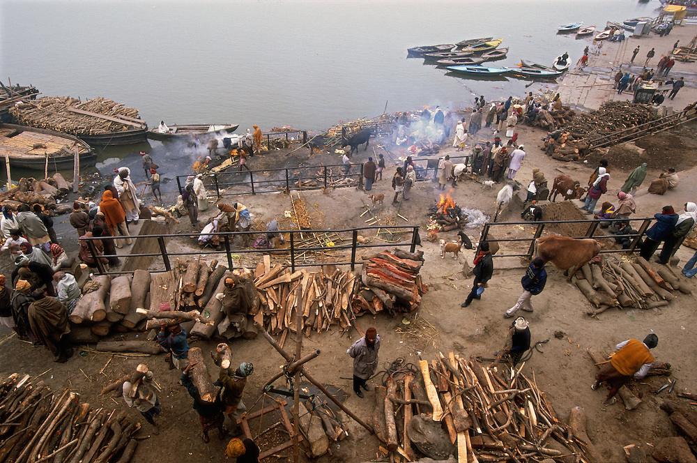 Manikarnika Ghat, the main cremation ghat of Varanasi, India, where cremation pyres are burning 24 hours a day. The work at the cremation ghat is carried out by the Doms, traditionally looked upon as untouchables. The ghat leads down to the sacred River Ganges. To be cremated in the holy city of Varanasi means a straight passage to heaven, many Hindus believe.